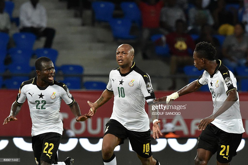 Ghana's forward Andre Ayew (C) celebrates with teammates after scoring his team's second goal during the 2017 Africa Cup of Nations quarter-final football match between DR Congo and Ghana in Oyem on January 29, 2017. / AFP / ISSOUF