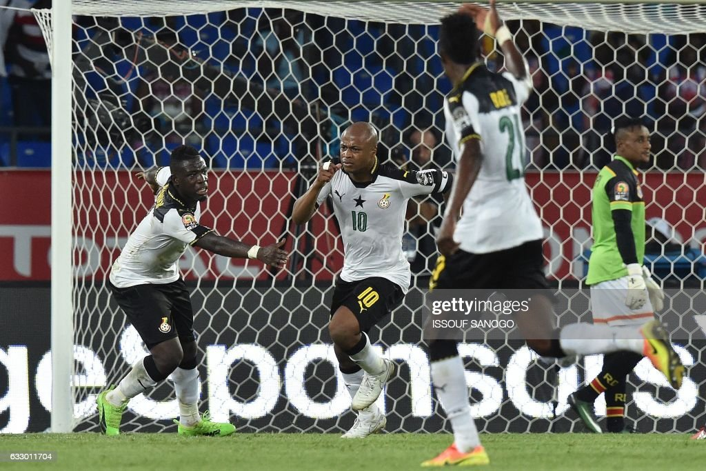 Ghana's forward Andre Ayew (C) celebrates with teammates after scoring his team's second goal during the 2017 Africa Cup of Nations quarter-final football match between DR Congo and Ghana in Oyem on January 29, 2017. /