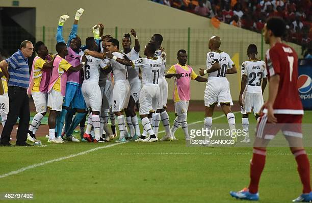 Ghana's forward Jordan Ayew is congratulated by teammates after scoring a goal during the 2015 African Cup of Nations semifinal football match...