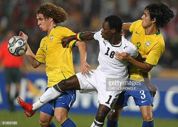 Ghana's forward Ransford Osei vies for the ball with Brazil's defenders Renan and Dalton during their FIFA U20 World Cup final football match in...