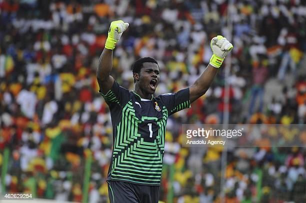 Ghana's goal keeper Razak Brimah celeberates his tea mate Christian Atsu's goal during the 2015 African Cup of Nations quarter final match between...