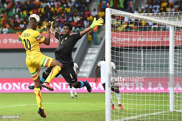 TOPSHOT Ghana's goalkeeper Brimah Razak blocks a shot on goal by Mali's forward Kalifa Coulibaly during the 2017 Africa Cup of Nations group D...