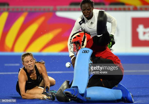 Ghana's goalkeeper Mavis AmpemDarkoa blocks a shot by New Zealand's Shiloh Gloyn during their women's field hockey match at the 2018 Gold Coast...