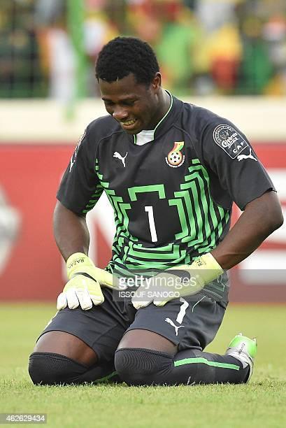 Ghana's goalkeeper Razak Brimah celebrates after winning the 2015 African Cup of Nations quarterfinal football match between Ghana and Guinea in...