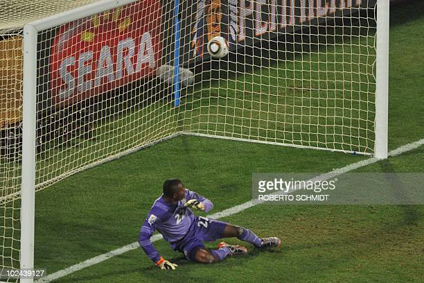 Ghana's goalkeeper Richard Kingson eyes the ball after conceding a goal by US midfielder Landon Donovan during the 2010 World Cup round of 16...