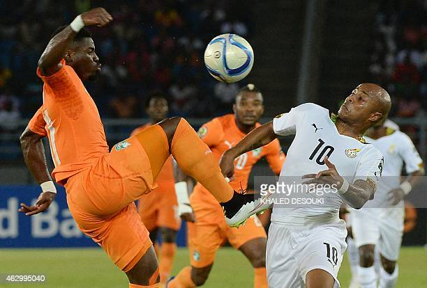 Ghana's midfielder Andre Ayew challenges Ivory Coast's defender Serge Aurier during the 2015 African Cup of Nations final football match between...