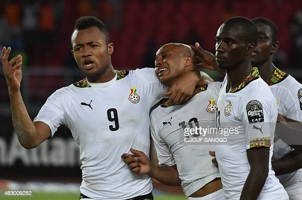 Ghana's midfielder Andre Ayew is comforted by his brother Ghana's forward Jordan Ayew at the end of the 2015 African Cup of Nations final football...