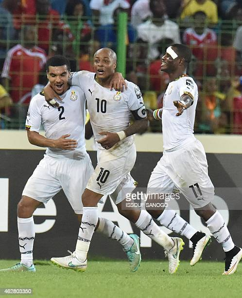 Ghana's midfielder Andre Ayew is congratulated by teammates after scoring a goal during the 2015 African Cup of Nations semifinal football match...