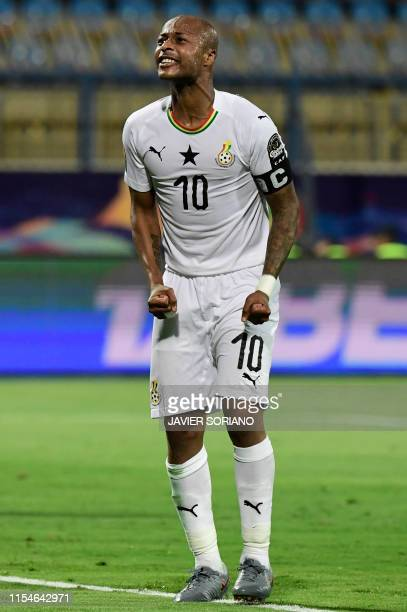 Ghana's midfielder Andre Ayew reacts to a missed chance during the 2019 Africa Cup of Nations Round of 16 football match between Ghana and Tunisia at...