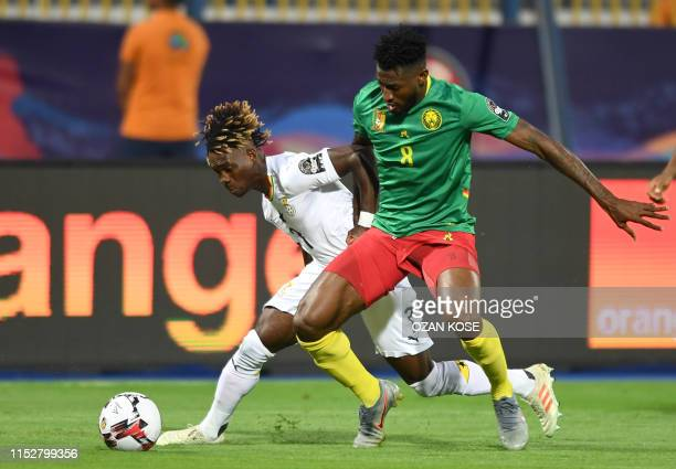 Ghana's midfielder Christian Atsu vies for the ball with Cameroon's midfielder AndreFrank Zambo Anguissa during the 2019 Africa Cup of Nations Group...