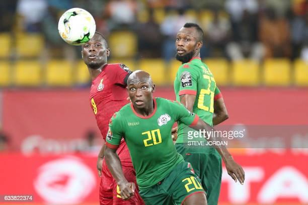 TOPSHOT Ghana's midfielder Emmanuel Agyemang Badu challenges Burkina Faso's defender Yacouba Coulibaly and Burkina Faso's midfielder Ibrahimi Blati...