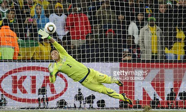 Ghana's midfielder Stephen Appiah scores past Uruguay's goalkeeper Fernando Muslera in the penalty shootouts during the 2010 World Cup quarterfinal...