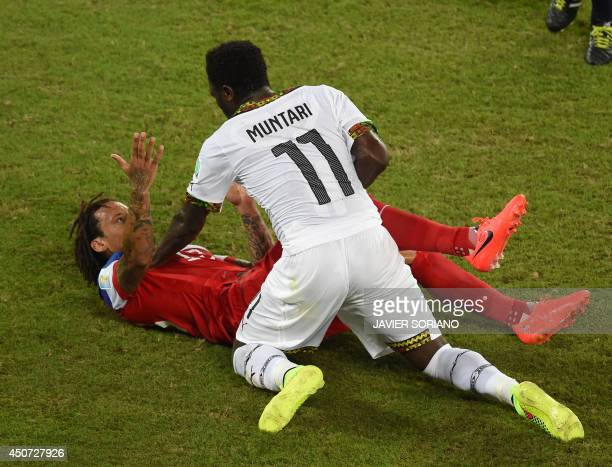 Ghana's midfielder Sulley Ali Muntari argues with US midfielder Jermaine Jones during a Group G football match between Ghana and US at the Dunas...
