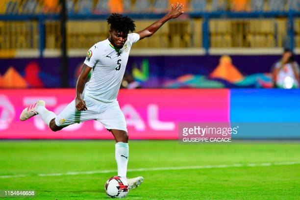 Ghana's midfielder Thomas Partey takes a penalty during the 2019 Africa Cup of Nations Round of 16 football match between Ghana and Tunisia at the...