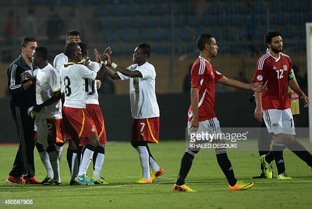 Ghana's players celebrate following their victory over Egypt in their WC2014 African zone qualifier second leg football playoff at the 30 June Air...