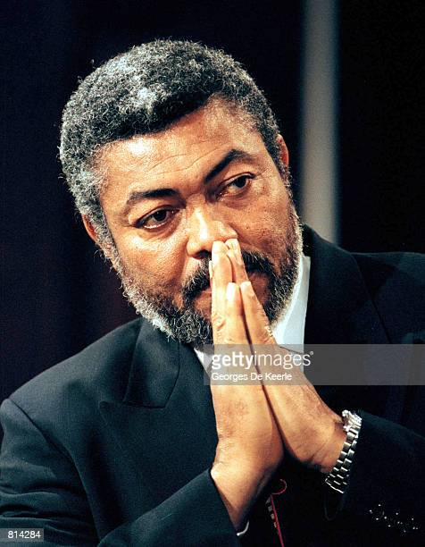 Ghana's President Jerry John Rawlings listens to President Bill Clinton during a press conference at the Old Executive Office Building in Washington...