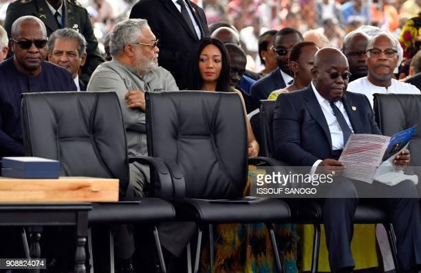 Ghana's President Nana AkufoAddo and Ghana's former presidents John Dramani Mahama and Jerry Rawlings attend the swearingin ceremony of Liberia's...