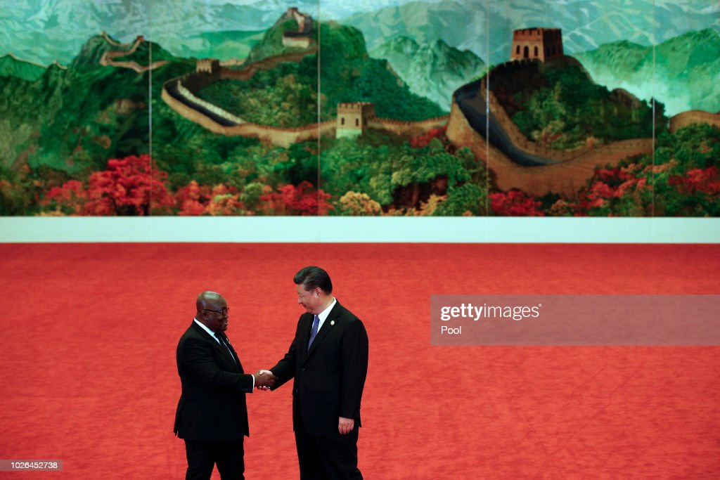 Ghana's President Nana Akufo-Addo, left, shakes hands with Chinese President Xi Jinping during the Forum on China-Africa Cooperation held at the Great Hall of the People on September 3, 2018 in Beijing, China.