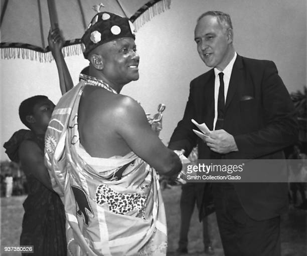 Ghana's Regional Chieftain Mampong Akwapim shaking hands with Surgeon General William Stewart at 25 millionth smallpox vaccinee celebration 1968...