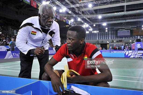 Ghana's Sam Daniel speaks to his coach during a Badminton Men's singles match against Aatish Lubah of Mauritius at the Emirates Arena during the 2014...