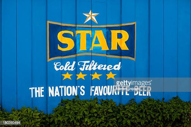 ghana's star beer freshly painted on wall - merten snijders bildbanksfoton och bilder