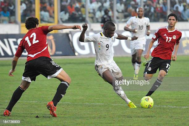 Ghana's striker Abdul Majeed Waris is about to strike next to Egypt's Sayed Moawad and Mohamed ElNenny during the Fifa World Cup 2014 qualifying...