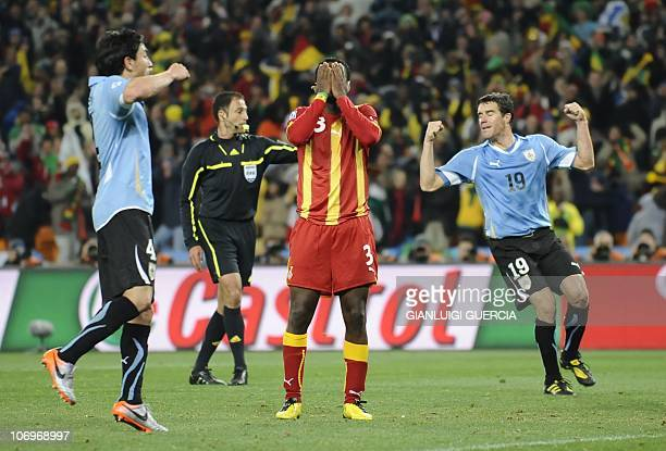 Ghana's striker Asamoah Gyan reacts after missing a penalty during the 2010 World Cup quarterfinal football match Uruguay vs Ghana on July 2 2010 at...
