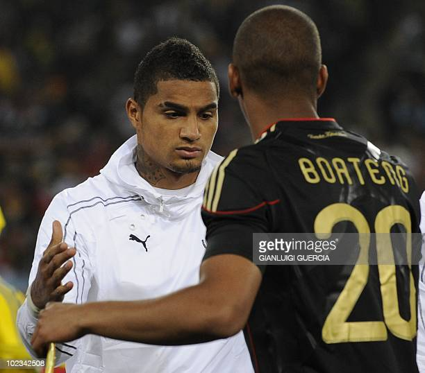 Ghana's striker KevinPrince Boateng shakes hands with Germany's defender Jerome Boateng prior to their Group D first round 2010 World Cup football...