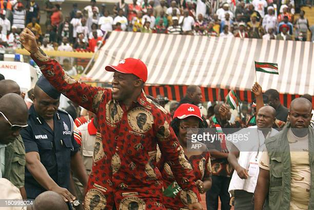Ghana's Vice President Kwesi Amissah Arthur waves to supporters on arrival at the Baba Yara stadium in Kumasi on August 30 2012 Ghana's ruling...
