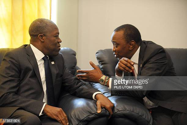 Ghana's Vice President Kwesi AmissahArthur discusses with Kenyan President Uhuru Kenyatta during a private meeting at the African Union Summit on...