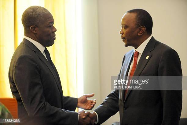 Ghana's Vice President Kwesi AmissahArthur shakes hand with Kenyan President Uhuru Kenyatta during a private meeting at the African Union Summit on...