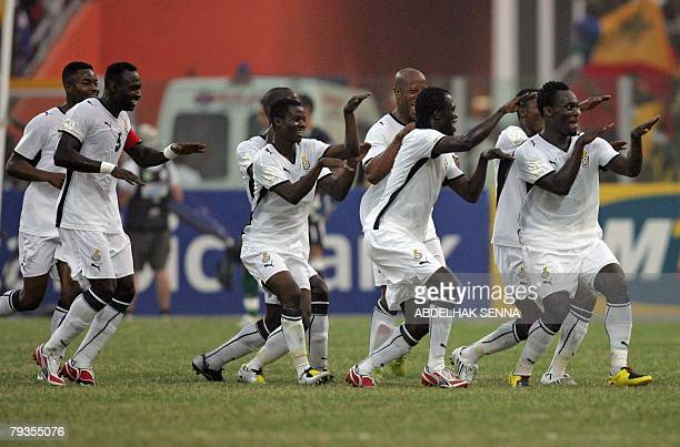 Ghanean players celebrate theiur 2-0 victory over Morocco after their Group A 2008 African Nations Cup quarter-final football match 28 January 2008...