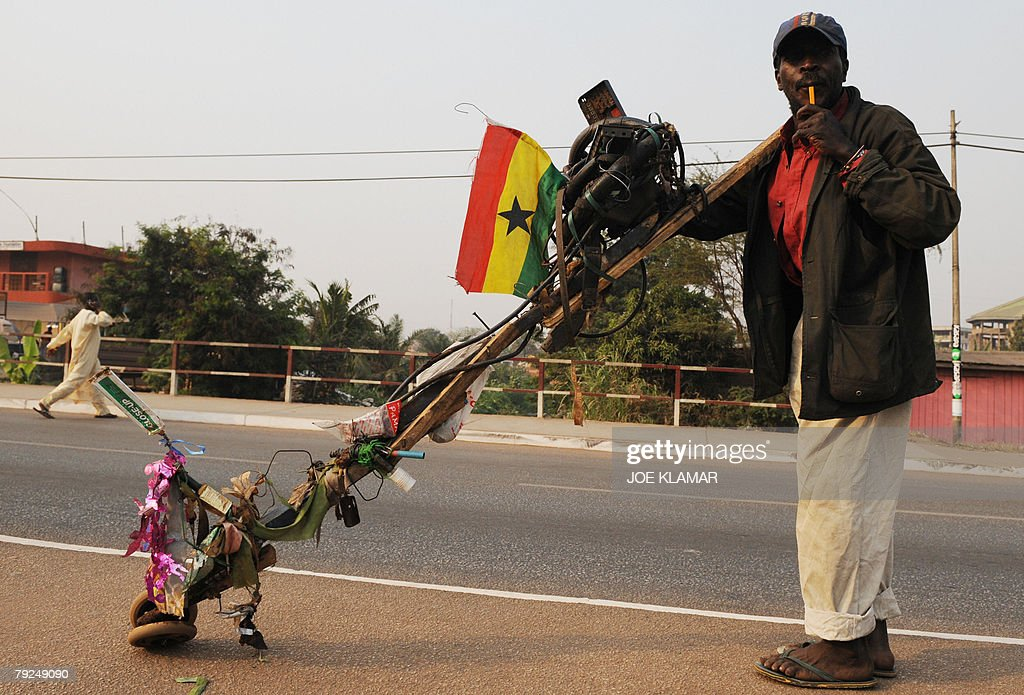 A Ghanian man pushes his invention on wheels in the center of Kumasi 25 January, 2008, during the African Cup of Nations football championship.