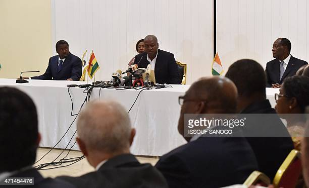Ghanian President and ECOWAS Chairmen John Dramani Mahama speaks during a press conference with Ivory Coast President Alassane Ouattara and Togo's...