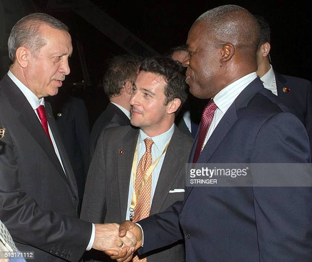 Ghanian Vice President Kwesi Bekoe AmissahArthur shakes hand with Turkish President Recep Tayyip Erdogan upon his arrival in Accra on February 29...