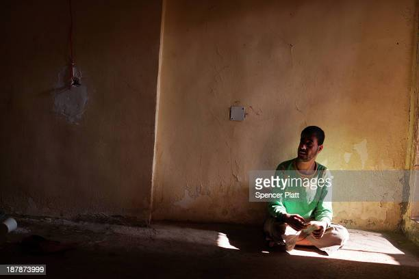 Ghareeb Alisper who suffers from a condition that prevents him from walking sits in the room he shares with over 10 other Syrian refugees in an...