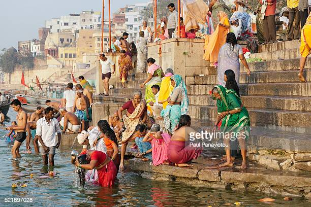 ghats in varanasi, india - taking a bath stock pictures, royalty-free photos & images