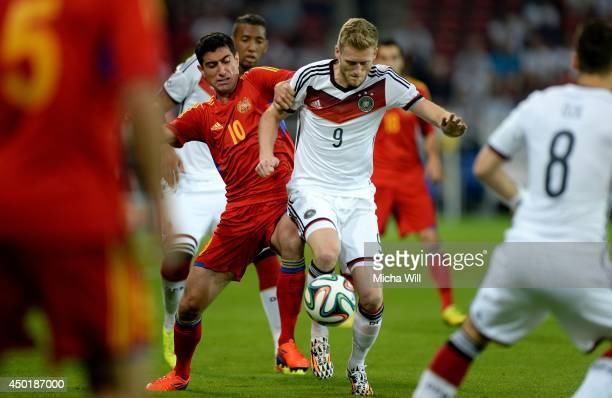 Ghazaryan of Armenia and Andre Schuerrle of Germany tu# during the international friendly match between Germany and Armenia at Coface Arena on June 6...