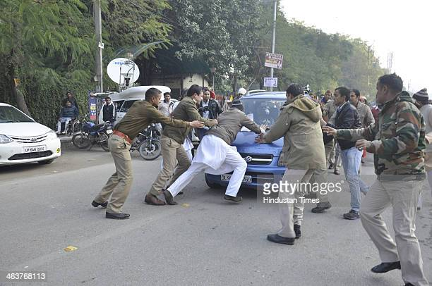 Ghaziabad police personals trying to stop an activist of Hindu Raksha dal and Hindustan Nirman Dal as he protests and demanding withdrawal of police...