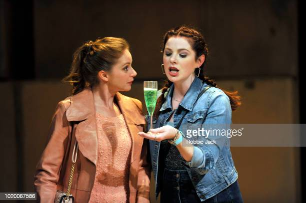 Kate Batter as Polly Peachum and Olivia Brereton as Lucy Lockit in Theatre des Bouffes du Nord's production of Ian Burton and Robert Carsen's...