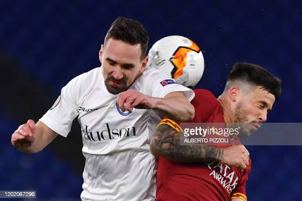 Ghent's Belgia midfielder Sven Kums fights for the ball with As Roma Spanish forward Carles Peres during the UEFA Europa League round of 32 first leg...