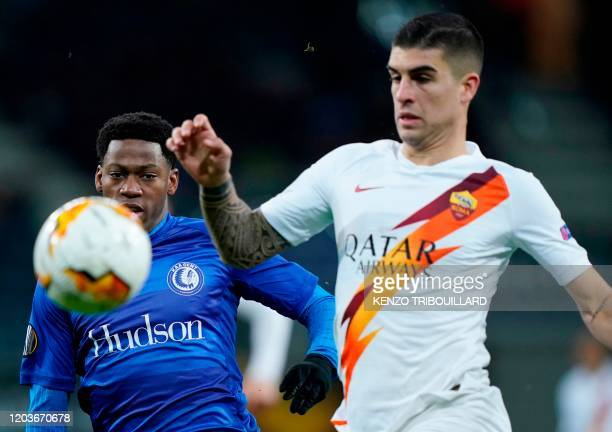 Ghent's Canadian forward Jonathan David is challenged by AS Roma's Italian defender Gianluca Mancini during the UEFA Europa League round of 32 second...