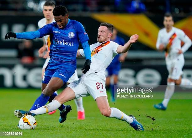 Ghent's Canadian forward Jonathan David is challenged by AS Roma's French midfielder Jordan Veretout during the UEFA Europa League round of 32 second...