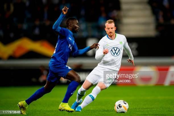 Ghent's Ghanaian defender Nana Asare fights for the ball with Wolfsburg's German midfielder Maximilian Arnold during the Europa League Group I...