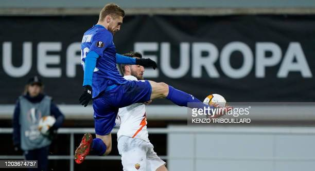 Ghent's Ukrainian defender Igor Plastun controls the ball during the UEFA Europa League round of 32 second leg football match between KAA Gent and AS...