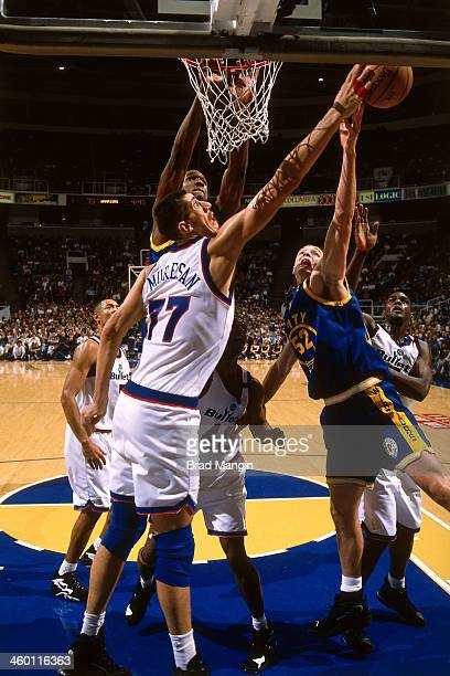 Gheorge Muresan of the Washington Bullets blocks a shot attempt against the Golden State Warriors circa 1997 at the OaklandAlameda County Coliseum...
