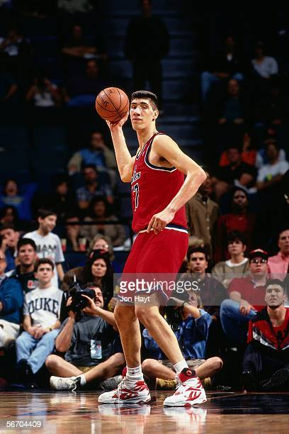 Gheorge Muresan of the Washington Bullets looks to pass the ball down court against the Miami Heat circa 1994 at Miami Arena in Miami Florida NOTE TO...