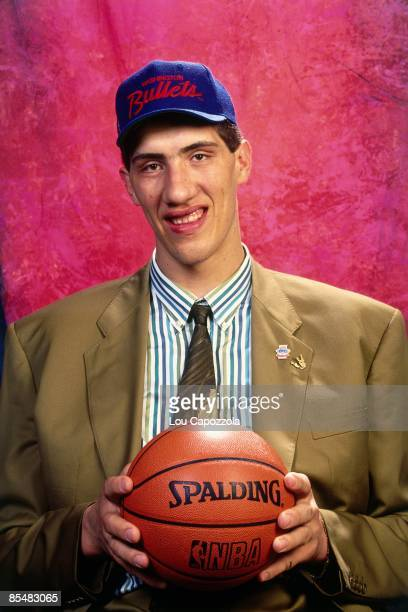 Gheorge Muresan selected number thirty overall by the Washington Bullets poses for a portrait during the 1993 NBA Draft on June 30 1993 at the Palace...