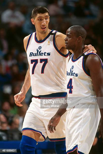 Gheorghe Muresan and Chris Webber of the Washington Bullets walk against the Golden State Warriors during a game played on December 15 1996 at the...