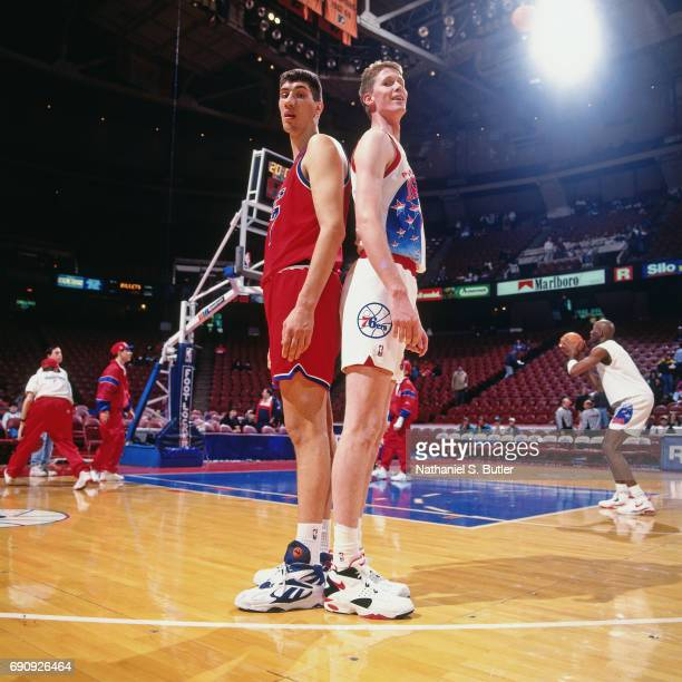 Gheorghe Muresan of the Washington Bullets and Shawn Bradley of the Philadelphia 76ers stand back to back circa 1994 at the Spectrum in Philadelphia...